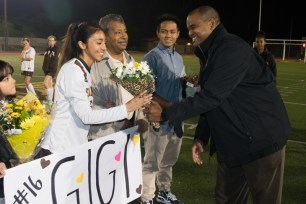 Angelica Ochoa receives flowers from Dr. Duane Coleman