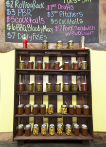 TBG! sells their own Hot & Mild BBQ Sauce, Marinated Green Beans, Okra.