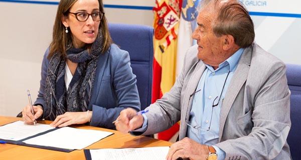 A conselleira de Infraestruturas e Vivenda, Ethel Vázquez Mourelle, e o alcalde do Bolo, Manuel Corzo, asinando o convenio.