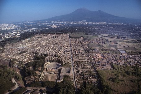 Aerial view of Pompeii and Mt. Vesuvius looking down to the amphiteater and the theater,