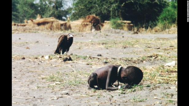 March 1993, Sudan --- Vulture Watching Starving Child --- Image by ?? Kevin Carter/Sygma/Corbis