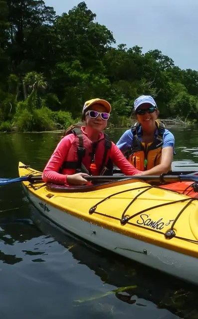 Kim in her fathom kayak and Delaney in her samba eddyline kayak