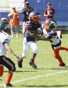 Brandon Bears' Pee-Wee division, Javielle Boyd Jr., runs the ball for a huge first down during a recent game against the Broncos. Boyd was hard to stop as he led his team to an easy win.