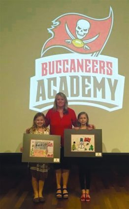 Madeline Kapsick and Kendra Smith, two of Valdez's fourth grade students, were selected as two of the 10 finalists in the Inaugural Holiday Card Art Exhibit sponsored by the Tampa Bay Buccaneers.