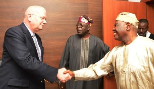 US Ambassador Shakes Hands with Chief Bisi Akande