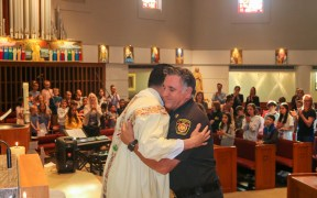 PASTOR EMBRACE LAFD CHIEF MASS GETTY FIRE