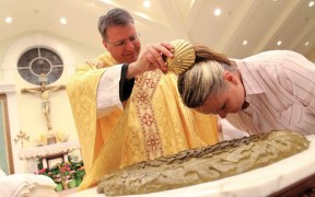 PRIEST BAPTIZES CATECHUMEN DURING EASTER VIGIL AT NEW YORK CHURCH