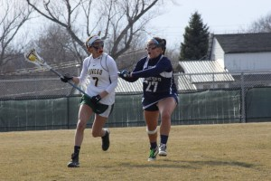 Junior Esther Gabriel (left) scored two goals in the Lakers' 12-6 loss to SUNY Geneseo (Alexander Simone | The Oswegonian).