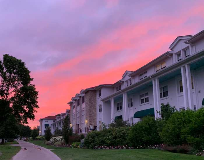 A family guide to enjoying Mission Point Resort on Mackinac Island, Michigan including a peek at the renovated rooms, what to eat, and things to do like renting bikes and put put golf.