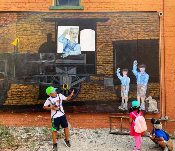 Take this self-guided art walk through Downtown Elgin with the family with stops for food, a playground, and candy!