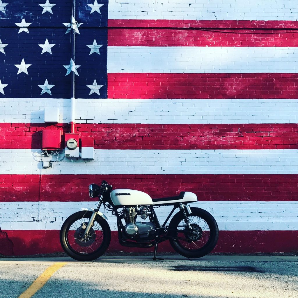 picture of cafe racer in front of American flag