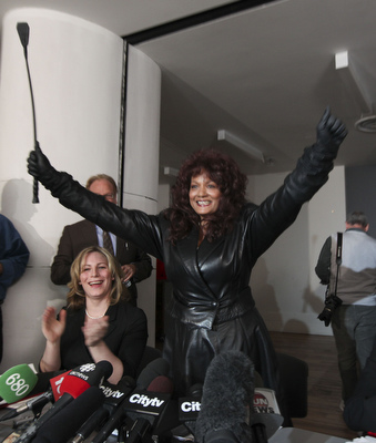 Dominatrix Terri-Jean Bedford , and and Nikki Thomas Executive Director of Sex Professionals of Canada celebrate during news conference in Toronto, March 26. The Court of Appeal for Ontario swept aside some of the country's  anti-prostitution laws, saying they place unconstitutional restrictions on prostitutes' ability to protect themselves.