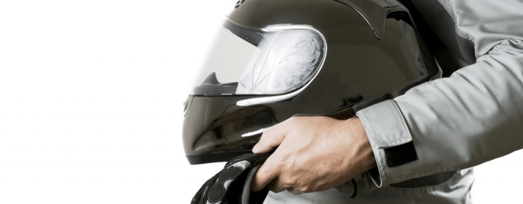 Man Holding Motorcycle helmet