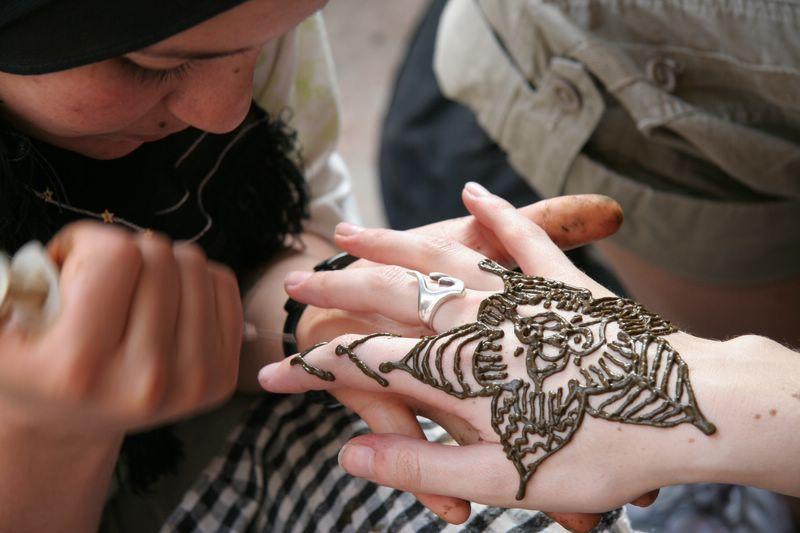 Travel and Transportation in Morocco - Getting henna art done high in the Atlas Mountains