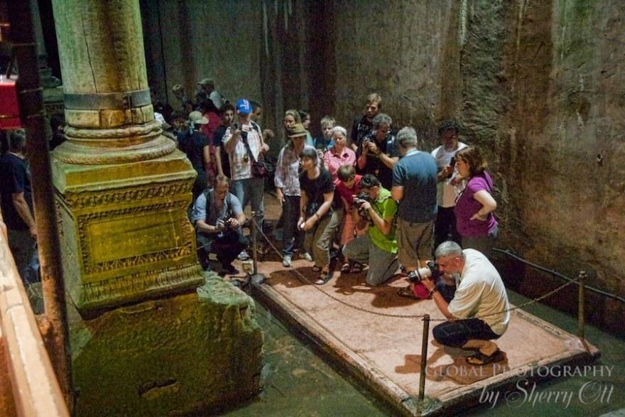 Tourists crowd around Medusa to snap a photo