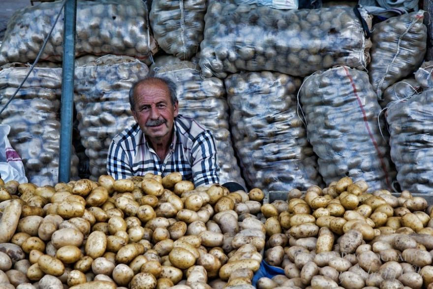 man selling potatoes at the selcuk market turkey