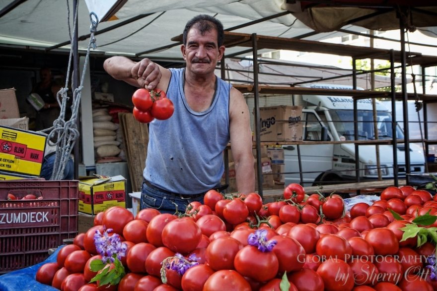 A man who is proud of his tomatoes