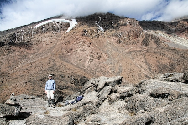 Me in front of Kilimanjaro covered in clouds