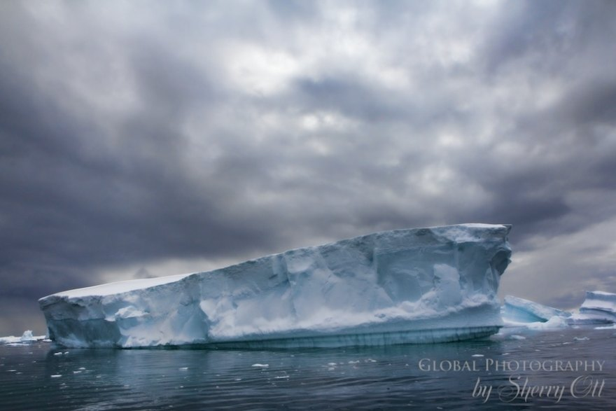 iceberg antarctica clouds landscape