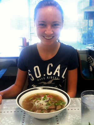 Evie eating Pho