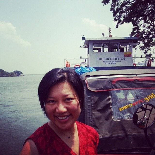 Riding a ferry with our Rickshaw in India