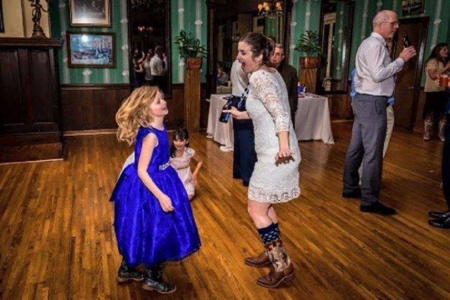 She literally danced all night. Don't mind the beer...it was my wedding and all. Photo by David Lund, F8 Industries