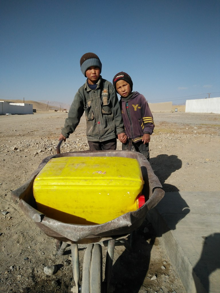 Kyrgyz kids at the village well