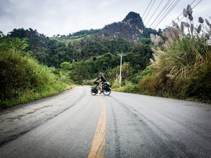 Zigzagging up the steep Laos hills