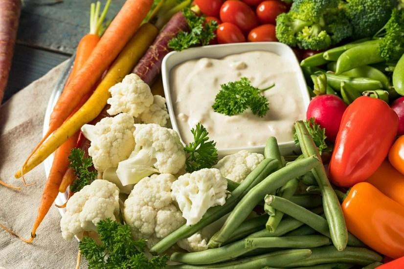 vegetables, carrots, green beans, cauliflower, sauce, vegetables on the table