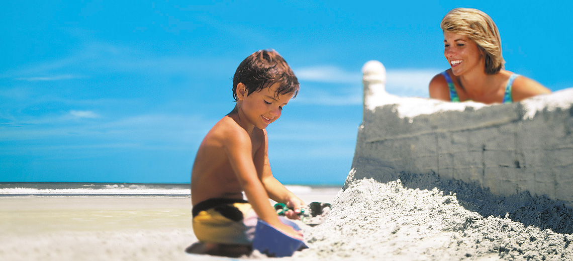 Boy building sandcastle at St.  Augustine beach