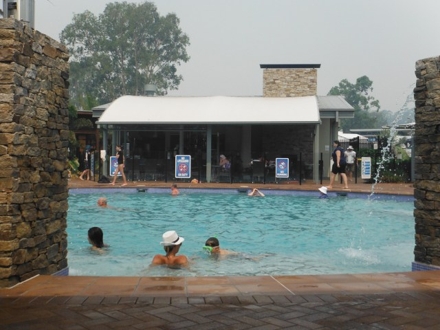 Pool with café & bar in background, bit of smoke haze from bushfire on Straddy