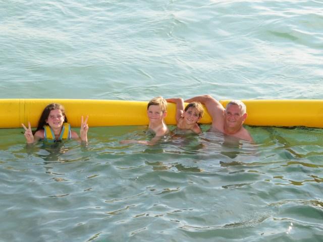 Having fun in the ocean pool with Dad