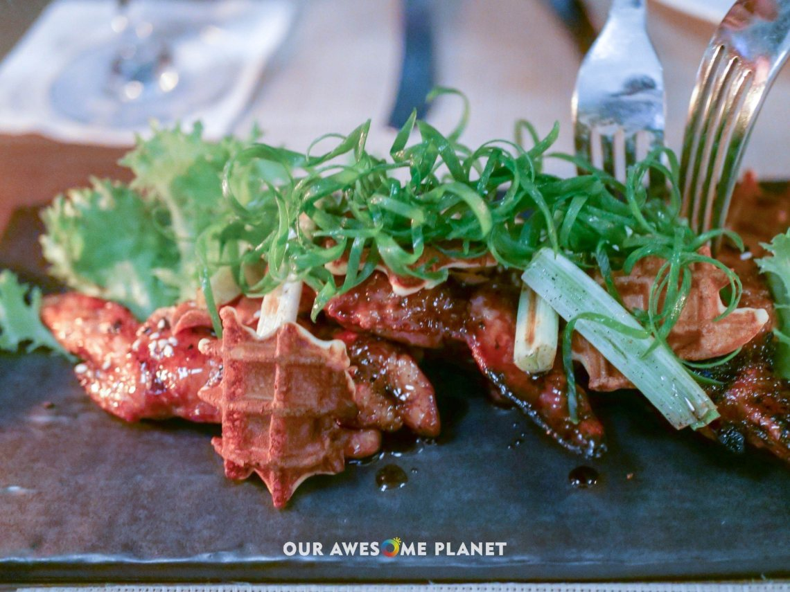 Josper Grilled U.S. Chicken Wings (₱420). Togarashi waffles, charred leeks, garlic chips, spring onions, teriyaki