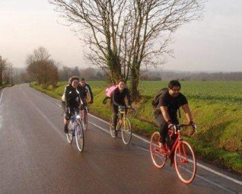 Sam and friends on a bike.