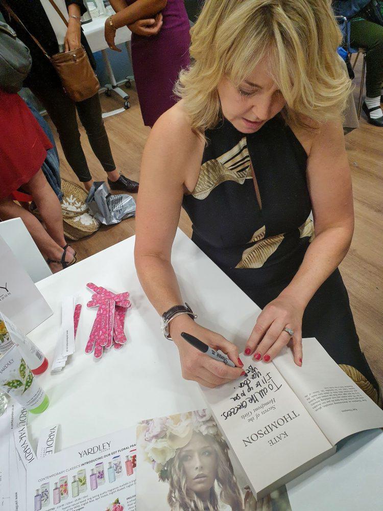 Kate Thompson signing books