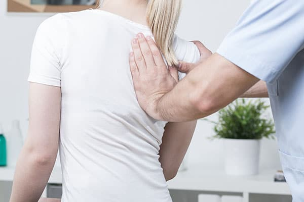 chiropractor cracking a back