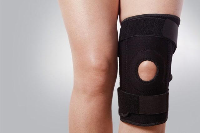 knee support brace on leg