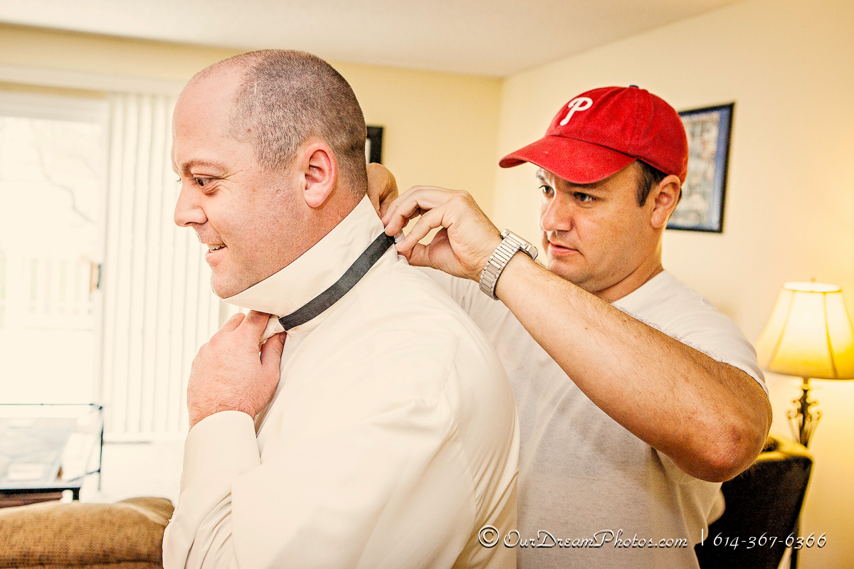 Guys getting ready at the Al's Apartment before the wedding of Jessica Gonzalez and Mark Tindle photographed Sunday, August 31, 2014. (© James D. DeCamp | http://OurDreamPhotos.com | 614-367-6366)