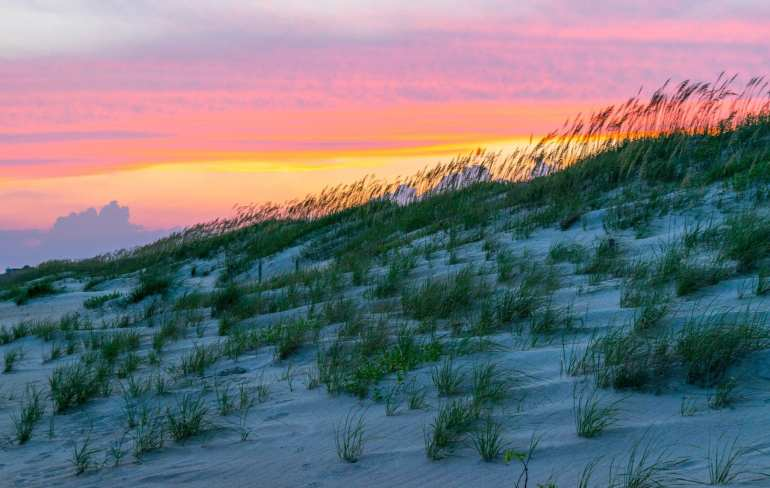 Best Things to Do in Beaufort NC: sunset over sand dunes