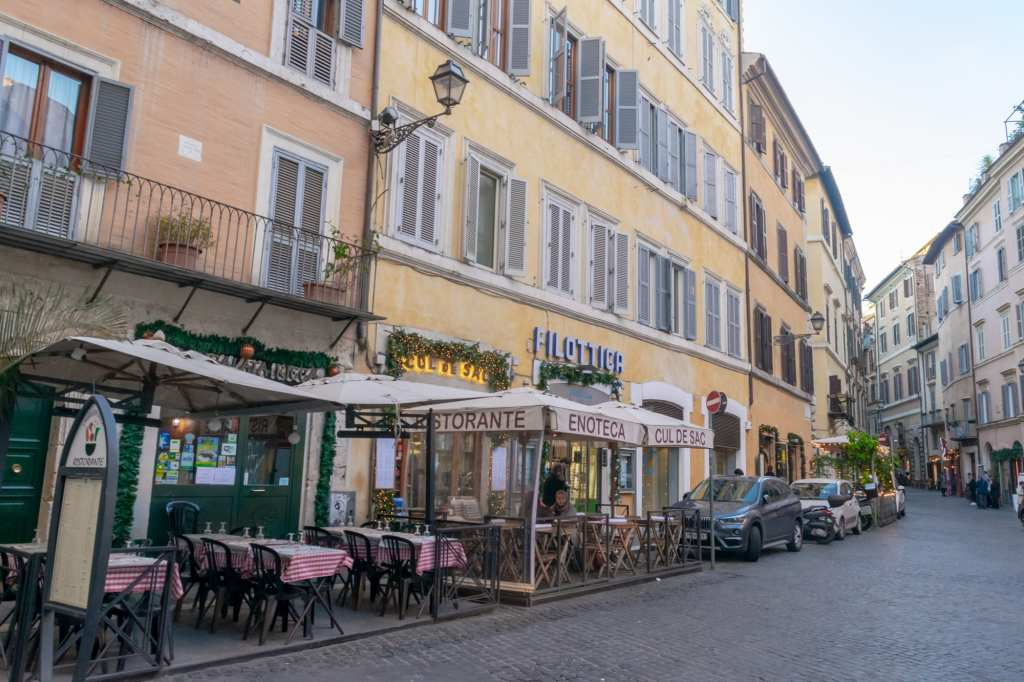 Street of light colored buildings in Centro Storico, Rome in a Day