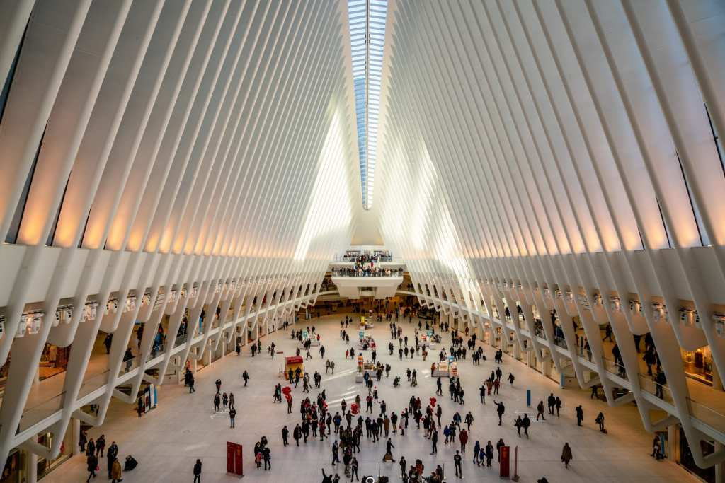 Interior of the Oculus Building in NYC with shoppers visible down below. It's worth stopping here for a oment during your one day in New York City!