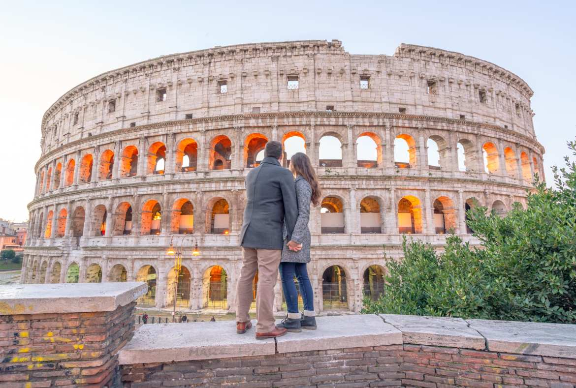 Couple in front of Colosseum: Visiting Rome in Winter