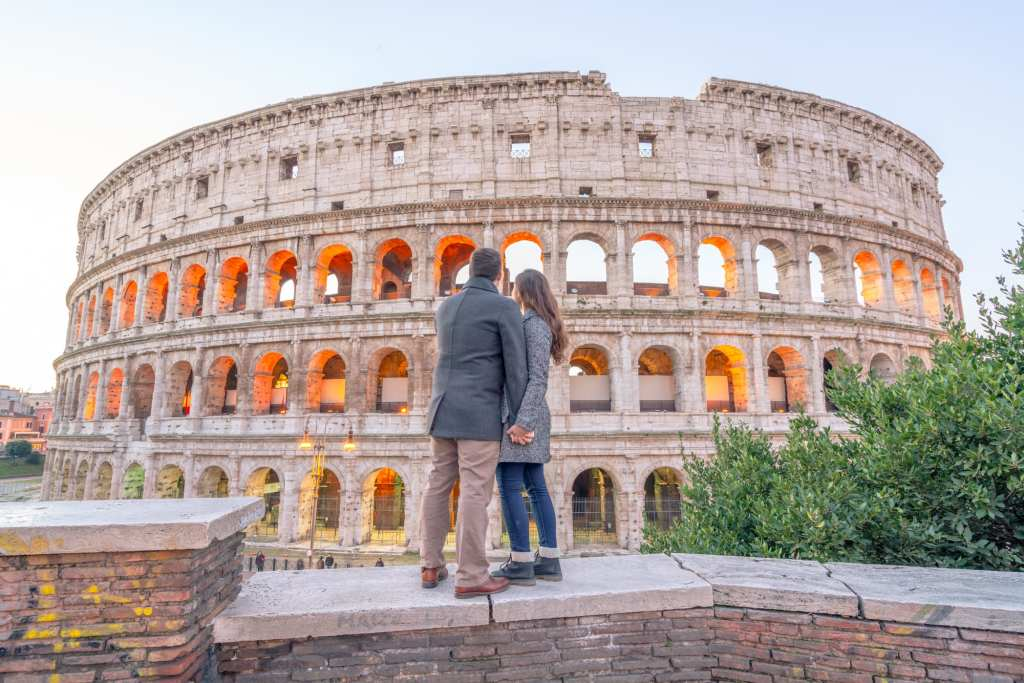 Couple standing in from of Colosseum, One Day in Rome -- Rome in a Day