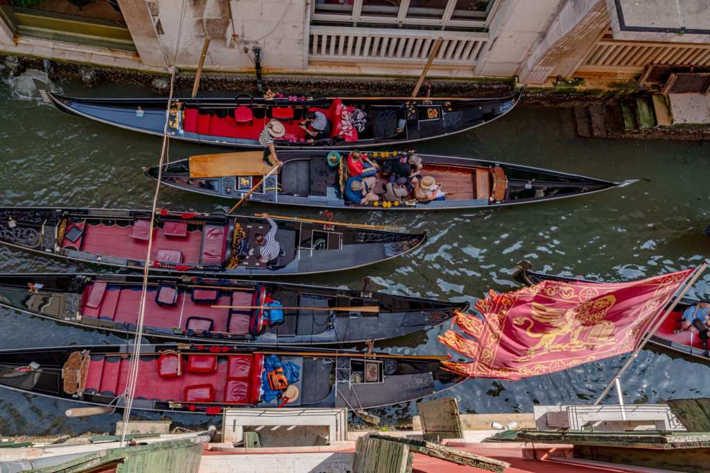 View of several Venice gondolas in a canal from above
