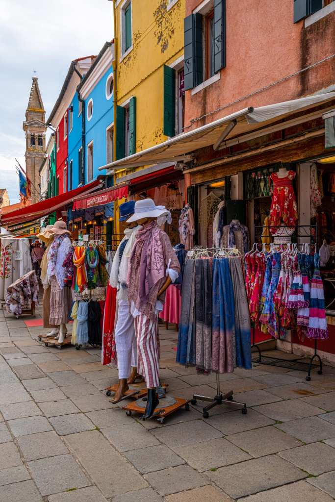 Street of Burano with clothes being displayed in front of a shop