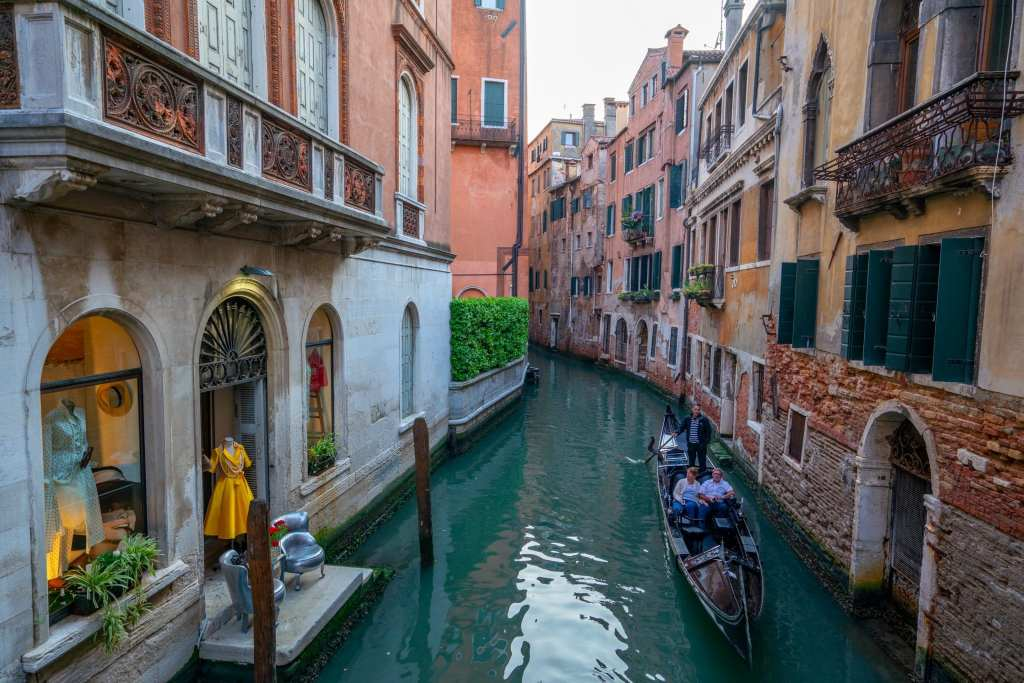 Photo of 2 gondolas in Venetian canal
