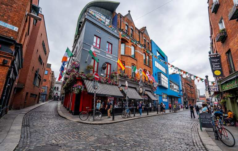 Cobblestone streets surrounding colorful buildings in Dublin Ireland