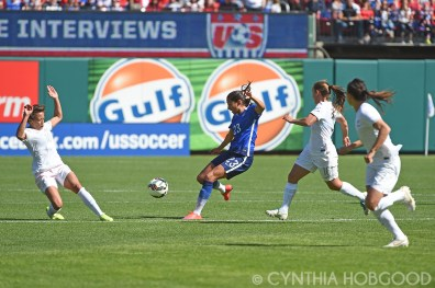 Christen Press (23) maneuvers agains New Zealand at Busch Stadium.
