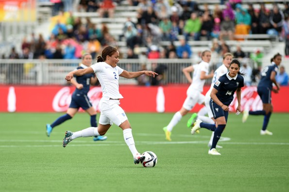 England's Alex Scott looks to attack.