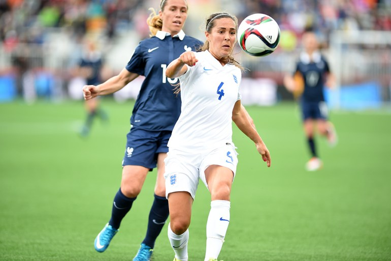 England's Fara Williams (4) and France's Camille Abily.